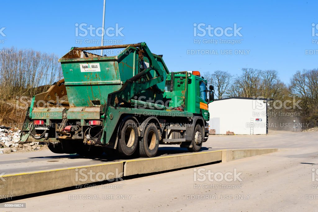 Container truck on scale stock photo