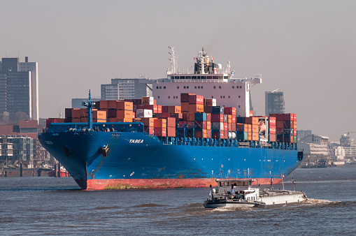 Container vessel Tabea is leaving the port of Hamburg.