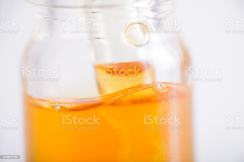 Container with CBD oil, cannabis live resin extraction isolated on white - medical marijuana concept stock photo