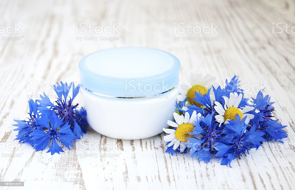 container with cream  and cornflowers royalty-free stock photo