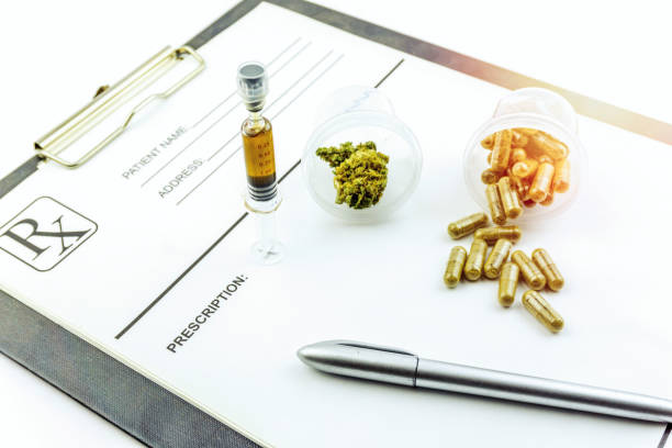 Container with medical Marihuana, cannabis resin concentrate and cannabis pills, medical marihuana concept stock photo