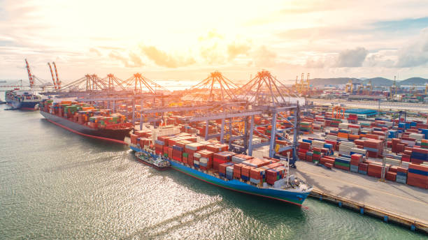 container,container ship in import export and business logistic,By crane,Trade Port , Shipping,cargo to harbor.Aerial view,Water transport,International,Shell Marine,transportation,logistic,trade,port stock photo