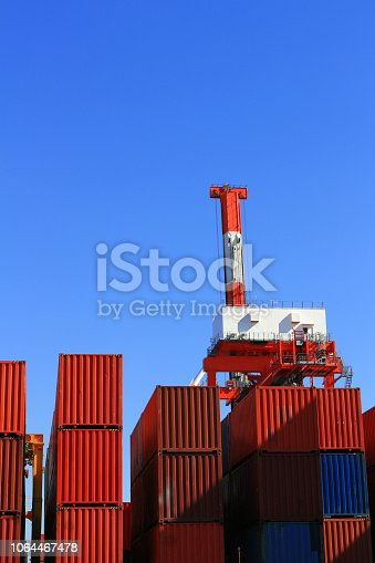697974610 istock photo Containers and cranes stacked in harbors 1064467478