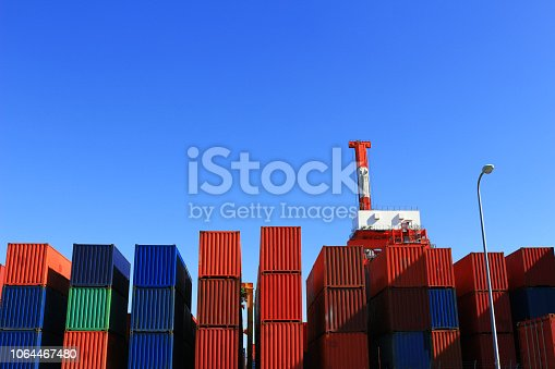 697974610 istock photo Containers and cranes stacked in harbors 1064467480