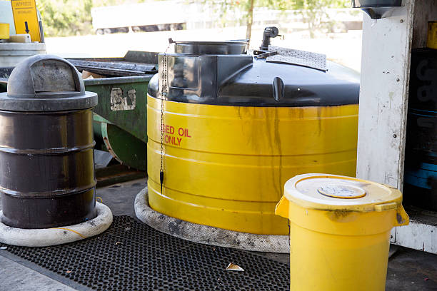 Containers for used motor oil at recycle center stock photo