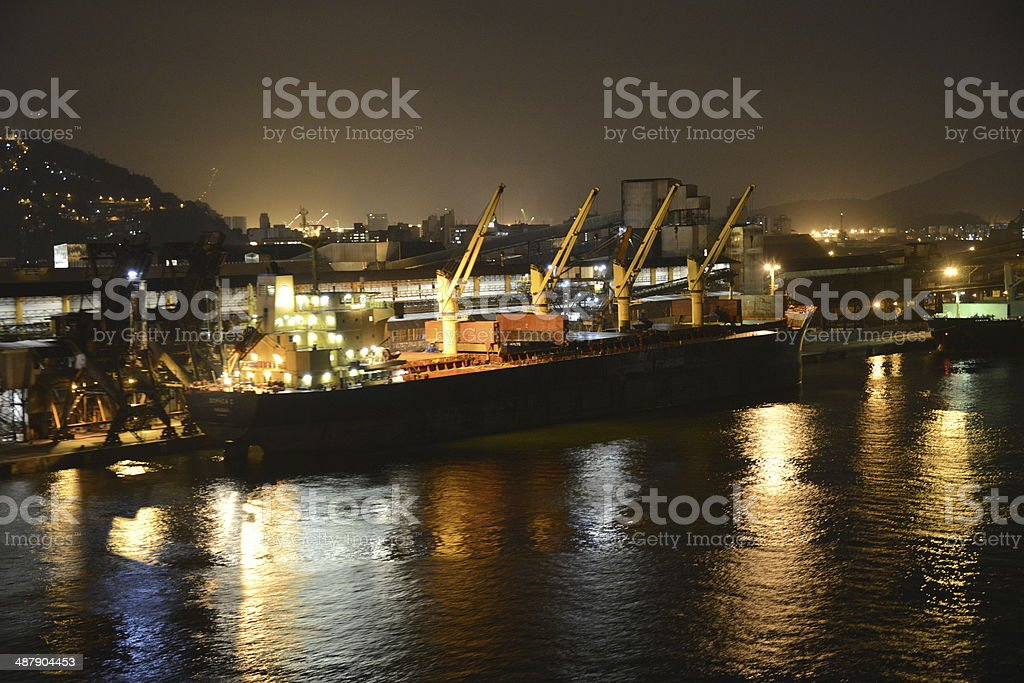 Containship Entering the Port of Santos, Brazil at Night stock photo