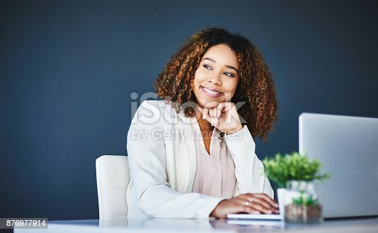 istock Contemplating her business ventures 876977914