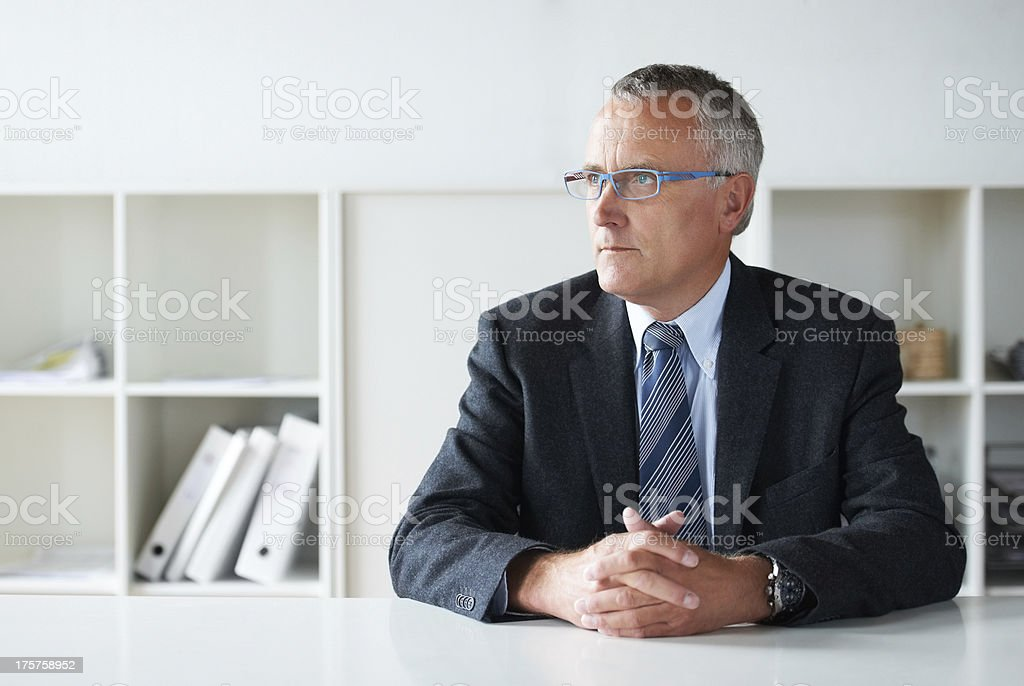 Contemplating his company's next move stock photo