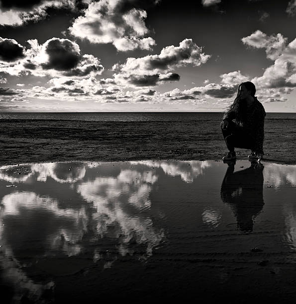Contemplating in Black & White. stock photo