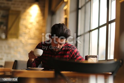 824167622istockphoto Contemplating things over coffee 1082031728