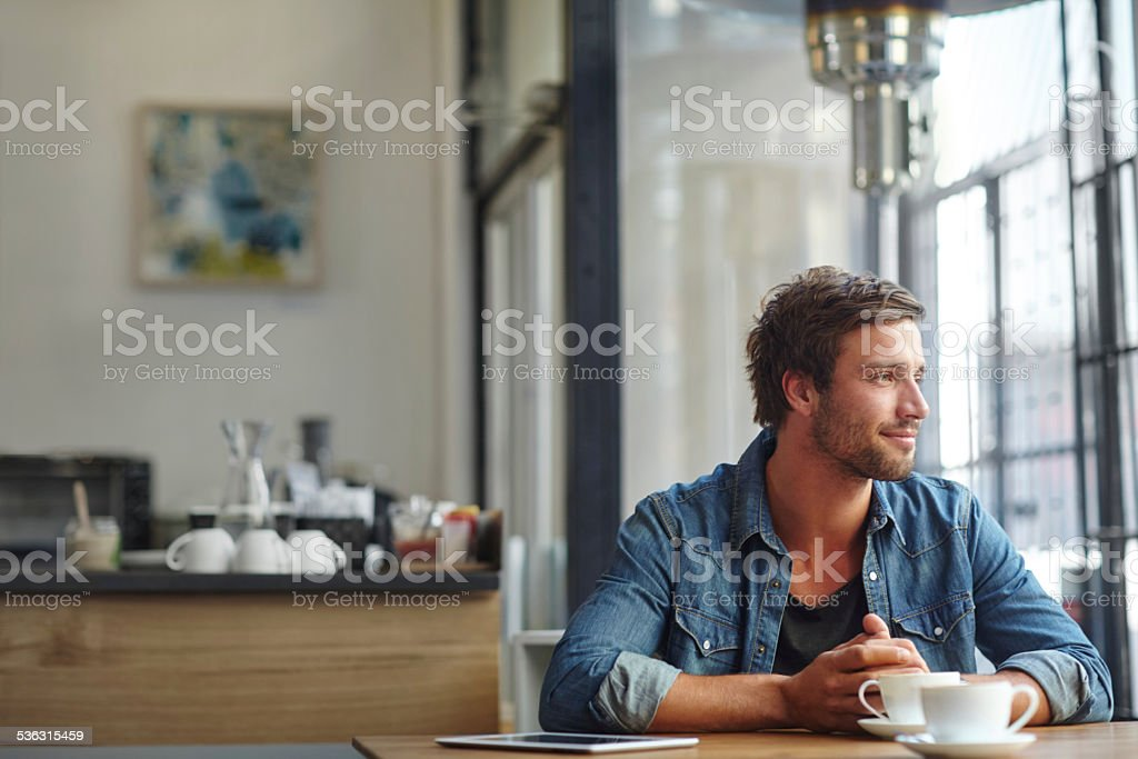 Contemplating things over coffee stock photo