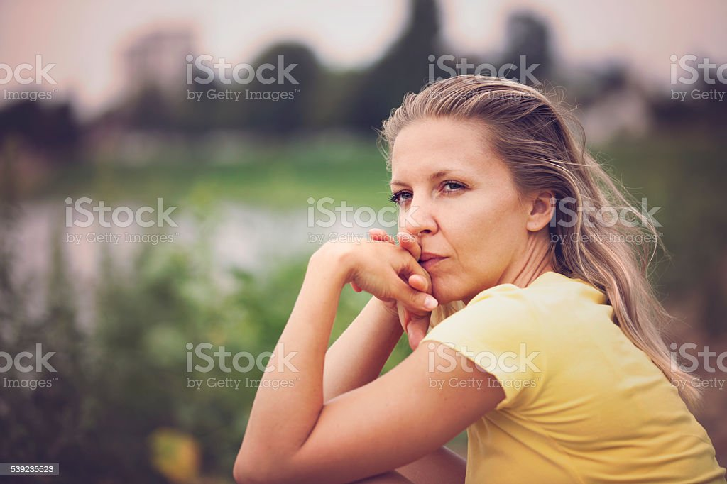 Contemplating woman outdoor portrait royalty-free stock photo