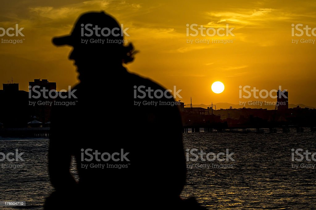 contemplation of the setting sun royalty-free stock photo