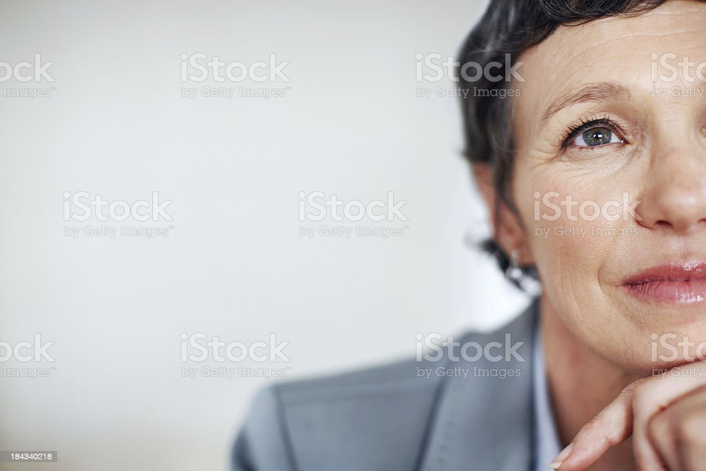 Contemplative business woman stock photo