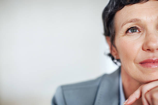 contemplative business woman - close to stock photos and pictures