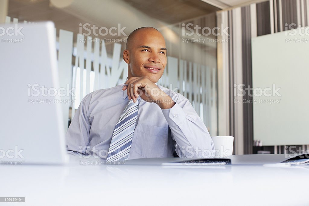 Contemplative businessman using laptop royalty-free stock photo