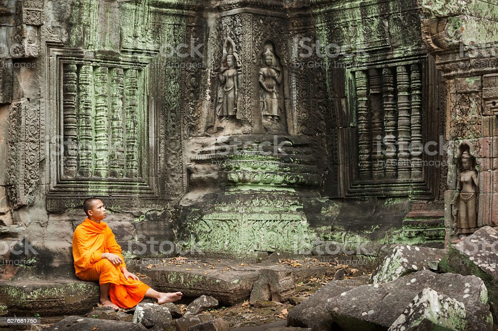 Contemplative monk at ruins stock photo