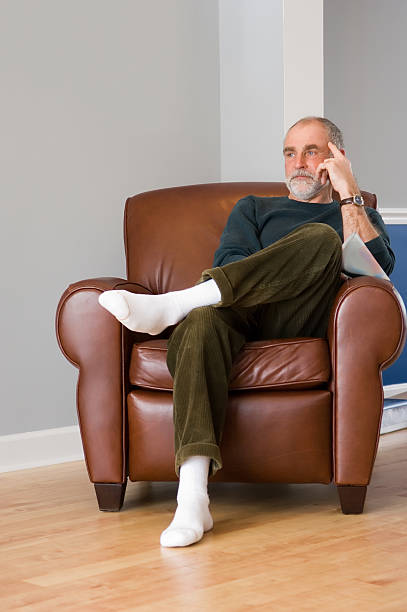 contemplative older gentleman - corduroy stock pictures, royalty-free photos & images