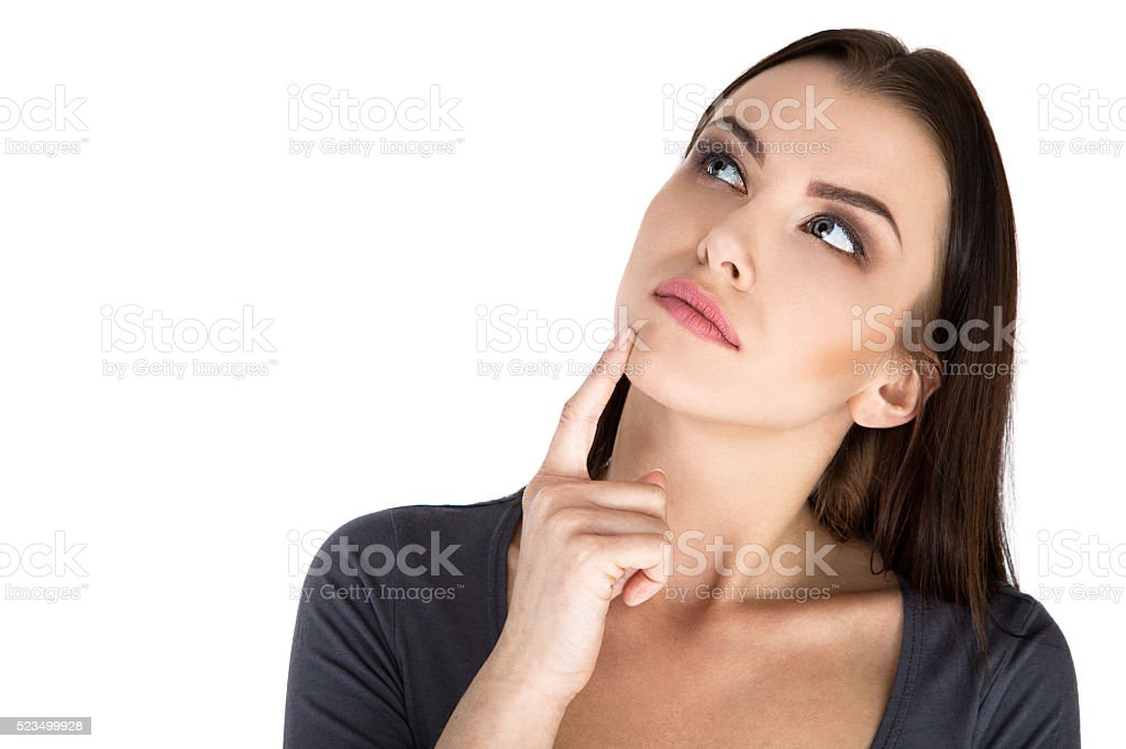 Contemplative thinking woman at a white background Stock Image stock photo