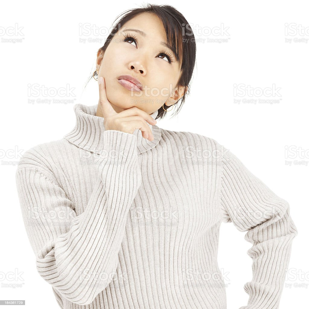 Contemplative Young Asian Woman in Gray Turtleneck Sweater royalty-free stock photo