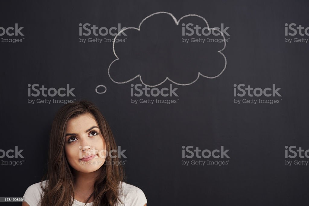 Contemplative young beautiful woman stock photo