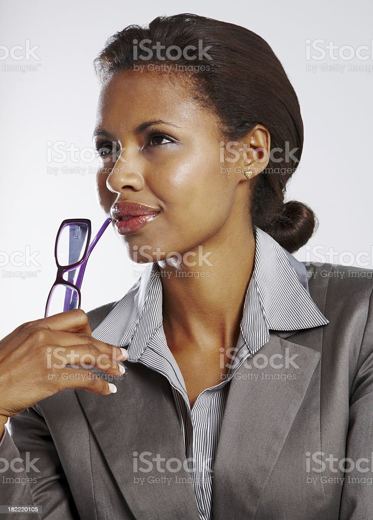 Contemplative young businesswoman looking away royalty-free stock photo