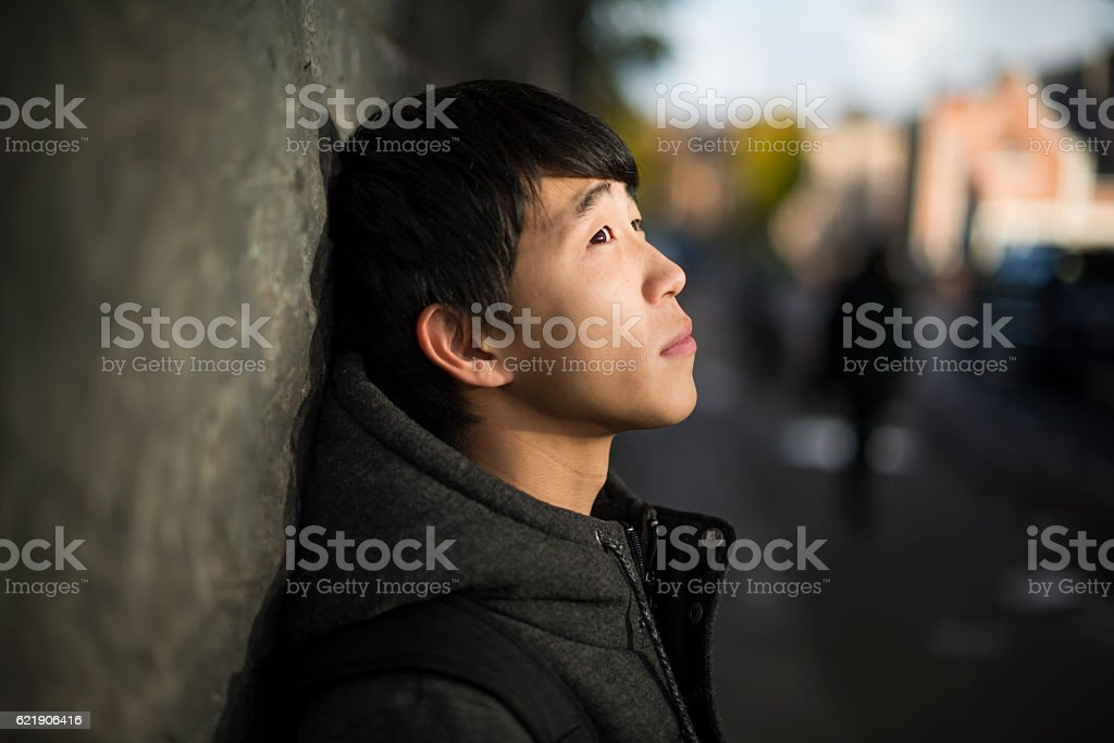 Contemplative young Japanese man royalty-free stock photo