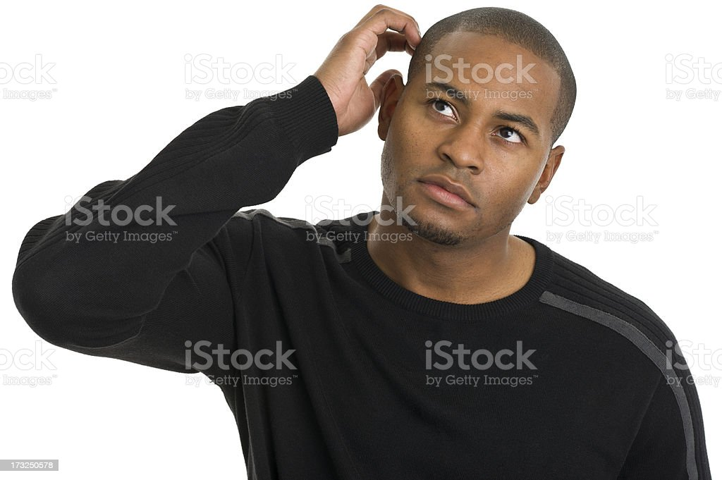 Contemplative Young Man Scratching Head royalty-free stock photo