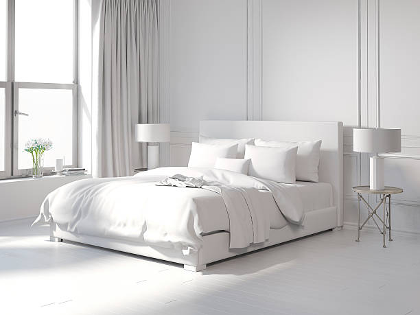 Contemporary all white bedroom stock photo