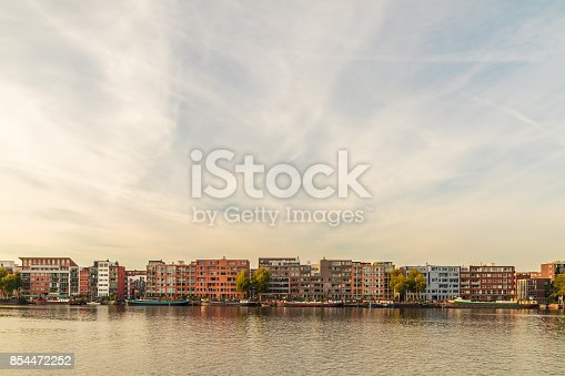 Contemporary apartment buildings and houseboats on the Amsterdam KNSM island in The Netherlands
