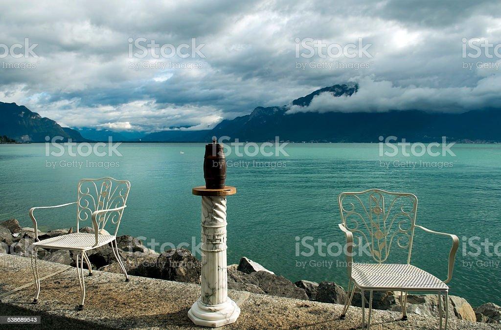 contemporary art, chairs and barrel, Lake Geneva, Vevey stock photo