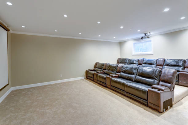 Contemporary basement movie room with black leather chairs stock photo