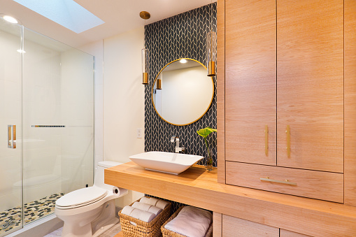 Contemporary Bathroom Design with Above Counter Vessel Sink and Vanity Glass Shower Stall and Toilet