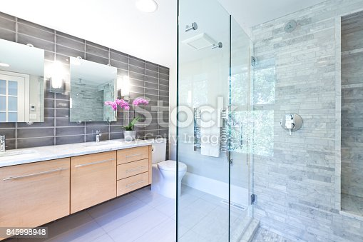 istock Contemporary Bathroom Design with Glass Shower Stall 845998948