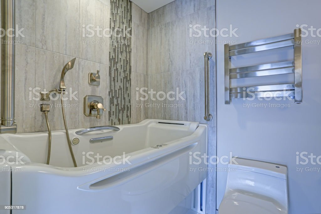 Contemporary bathroom design with hot tub Walk-in Bathtub stock photo