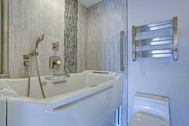 Contemporary bathroom design with hot tub Walk-in Bathtub Contemporary bathroom design boasts a luxury hot tub Walk-in Bathtub flanked by subway tiled interior accented with wide glass mosaic tiled vertical stripe bathtub stock pictures, royalty-free photos & images