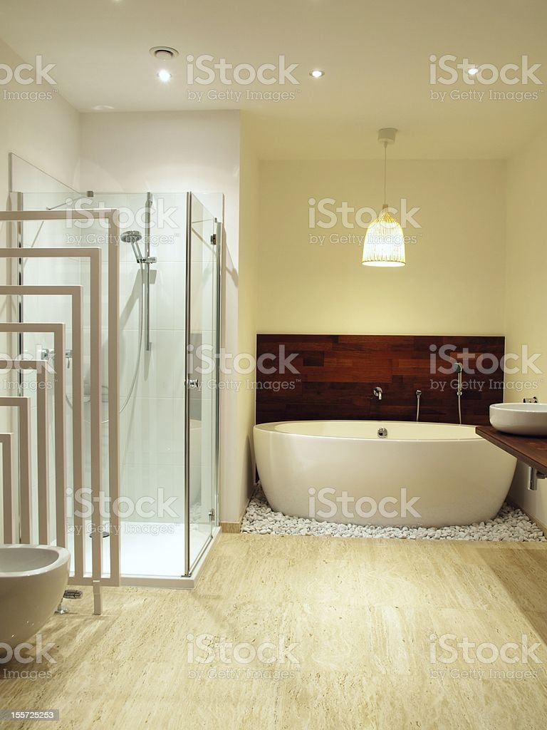 Contemporary bathroom with travertine tiles royalty-free stock photo