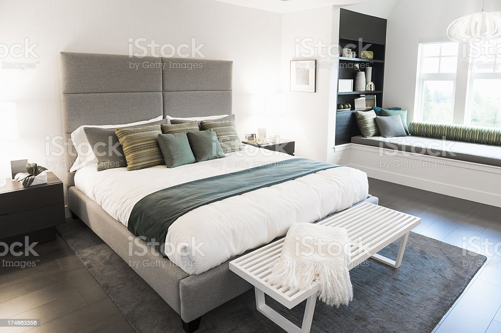 Contemporary bedroom with white colors stock photo
