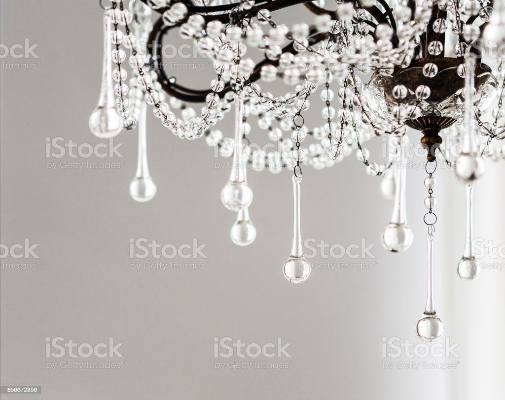 Contemporary crystal chandelier in room interior stock photo