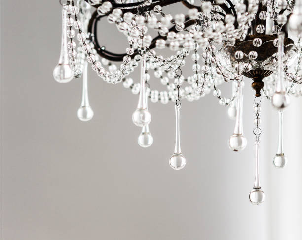 Contemporary crystal chandelier in room interior Contemporary crystal chandelier in room interior. Close up chandelier stock pictures, royalty-free photos & images