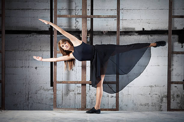 Contemporary Dance Performance Young dancer taking a modern dance performance in an urban industrial surrounding new age music stock pictures, royalty-free photos & images