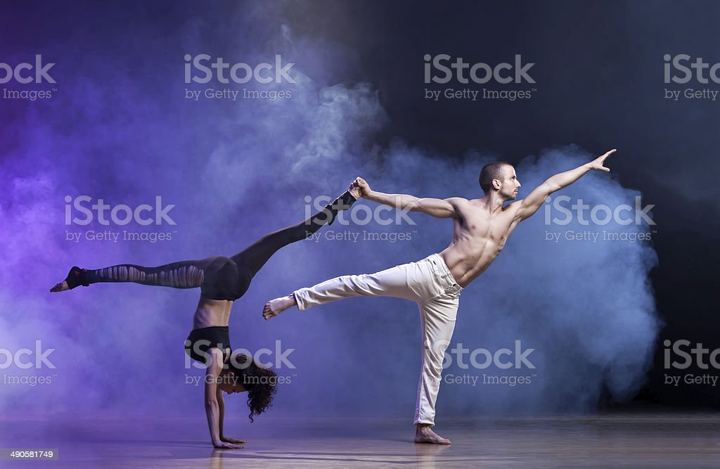 Contemporary Dance Sensual couple performing an artistic and emotional contemporary dance. 20-29 Years Stock Photo