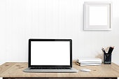 istock Contemporary desk Workplace with laptop and office Supplies concept. 860761036