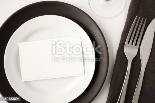Blank place card in contemporary dining table setting.You may also like: