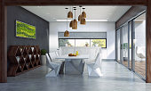Contemporary dining space with big sliding door and terrace.