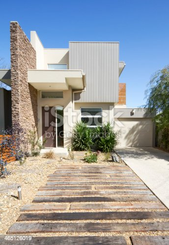 Front of a two storey contemporary architect designed townhouse home vertical format