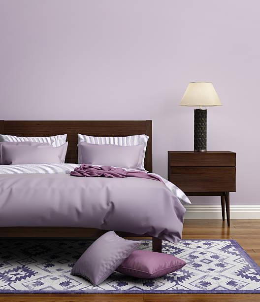 Contemporary elegant light purple luxury bedroom stock photo