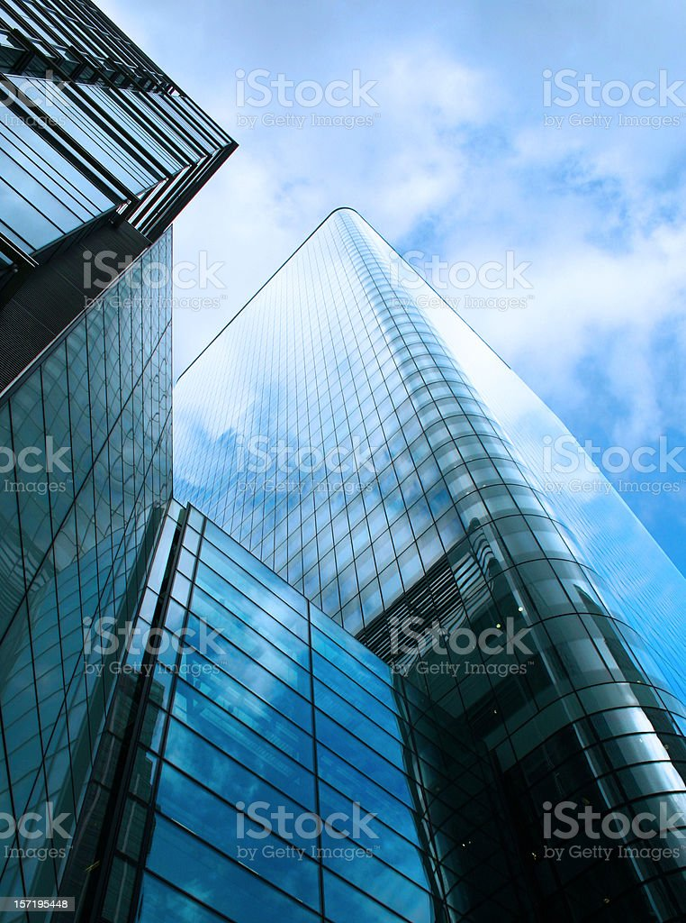 Contemporary glass skyscraper reflecting a blue overcast sky royalty-free stock photo