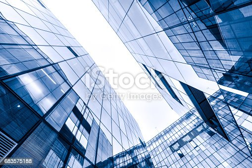 490774222istockphoto Contemporary glass skyscraper reflecting the blue sky 683575188