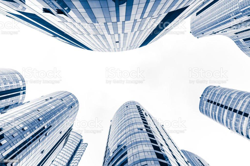 Contemporary glass skyscraper reflecting the blue sky stock photo
